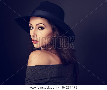 Expressive Makeup Woman In Fashion Elegant Hat Posing On Dark Shadow Background. Closeup Portrait. M
