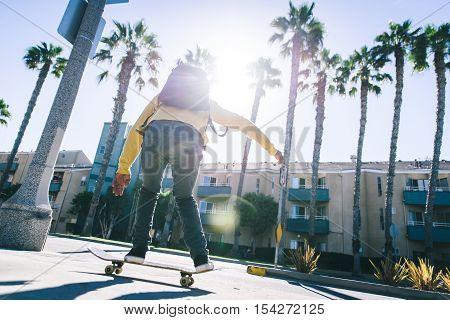 Skater boy on the street in Los angeles. Skateboarding in venice California