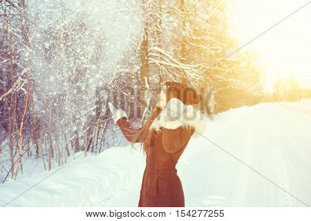 Woman In A Black Cap Throwing Snowball