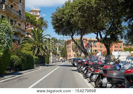 PORTOFINO, ITALY - AUG 7, 2016: Daytime traffic on street of Portofino in Liguria, famous Mediterranean sea town at the Italian Riviera.