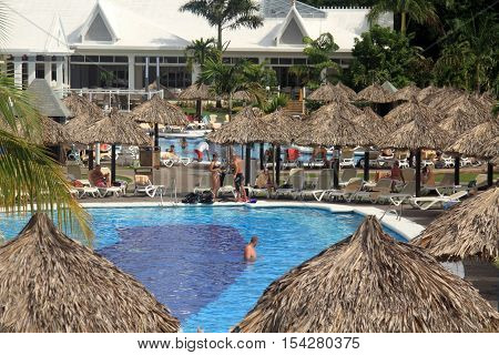 Negril Jamaica - October 15 2016. Tourists relax by the swimming pool. Exotic resort in Negril Jamaica.