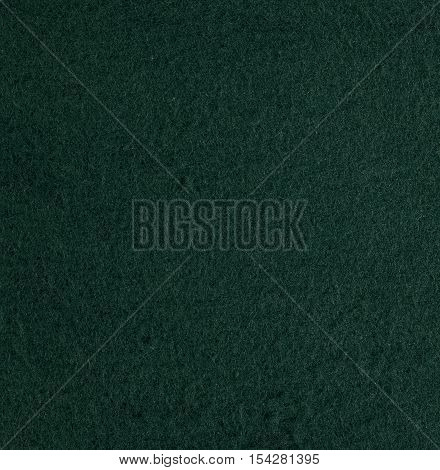 Green velour suede texture background. Square close up