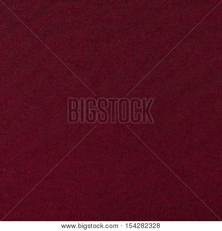 Red knitwear fabric texture background close up