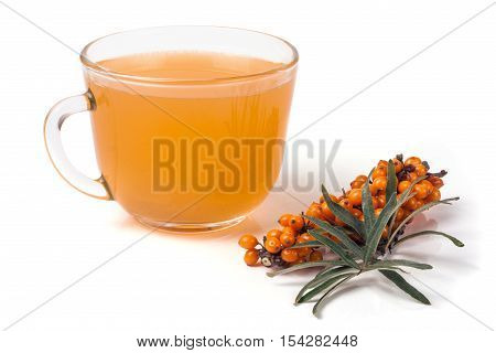 Sea buckthorn tea with a sprig isolated on a white background.