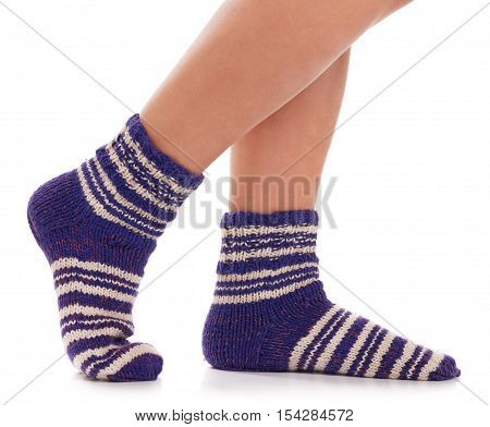 Knitted socks on the man feet isolated on white background