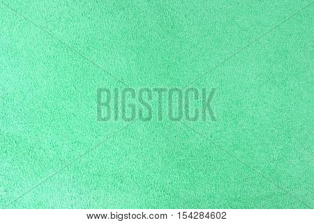 Green velour texture background vertical close up