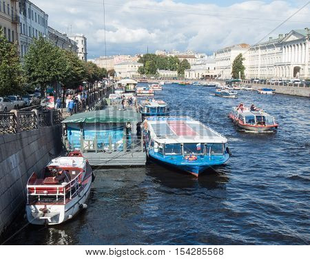 Saint Petersburg Russia September 15 2016: excursion boats sail along the river Fontanka in St. Petersburg Russia.
