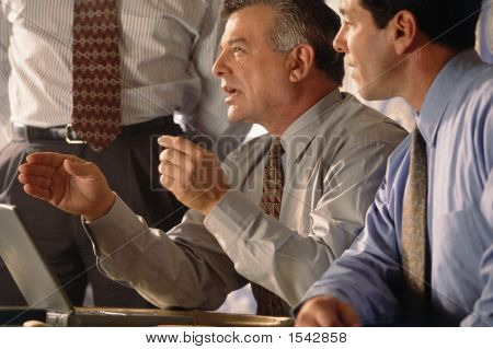 three businessmen with laptop