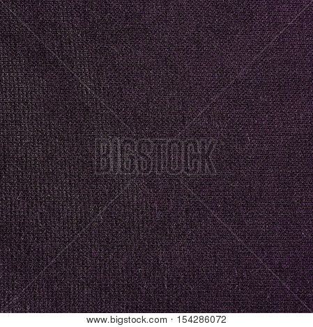 Purple knitwear fabric texture background close up