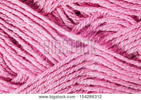 Skein of red knitting yarn close up
