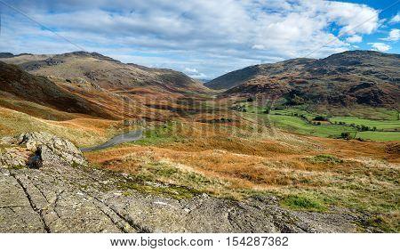 The view from the top of the Hardknott Pass in the Lake District - one of Britain's steepest and most treacherous roads with gradients of 33% and hairpin bends looking out over the Duddon Valley to the Wrynose Pass