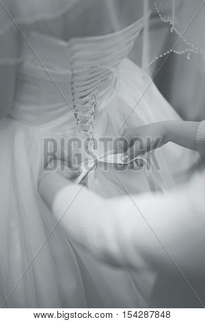 poster of Wedding dress back preparation bride corset and bow