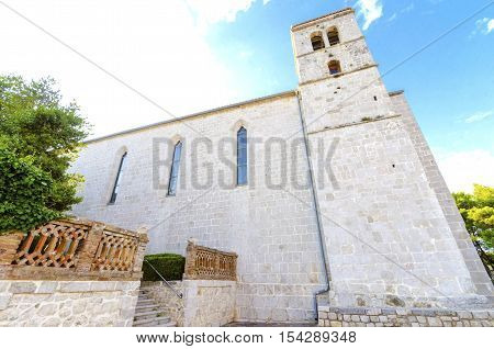 The bell tower of the gothic Church and monastery of St Francis a Franciscan cathedral of the renaissance period with a quadratic roof in the Glagolithic square on the island of Krk in Croatia.