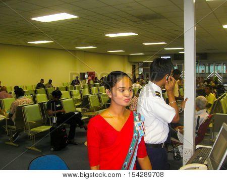 Colombo Sri Lanka - May 05 2009: The Young beautiful flight attendant in the Transit area at Bandaranaike International Airport at Colombo Sri Lanka