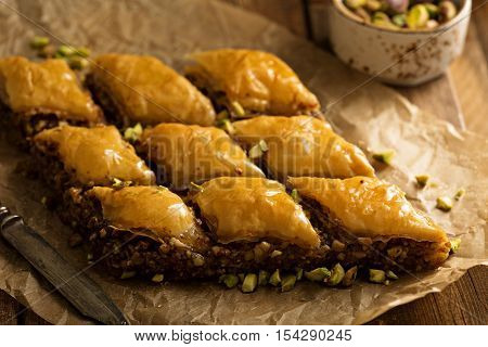Homemade baklava with pistachios and hazelnuts and honey syrup