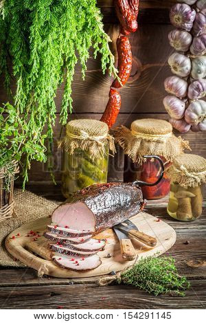 Pantry With Mortars, Smoked Ham And  Herbs