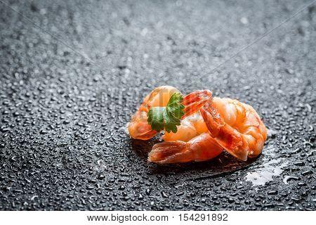 Closeup Of Fresh Shrimp On A Black Rock