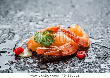 Fresh seafood ready to eat on black rock