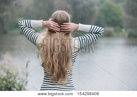 Long hair woman posing outdoor, watching scenary