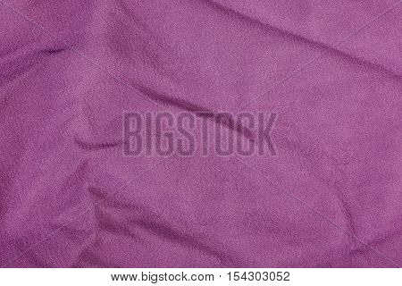 Fuchsia wrinkled fabric texture background. Close up
