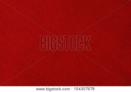 Red fabric closeup background with visible texture or pattern.