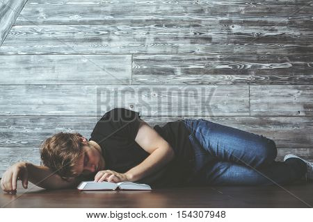 Man With Book Sleeping On Floor