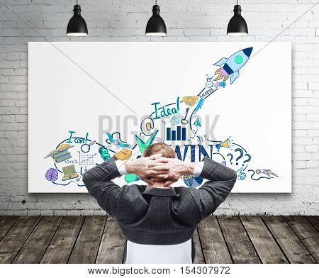 Back view of relaxing businessman looking at whiteboard with creative start up sketch in interior with brick wall ceiling lamps and wooden floor. Successful startup concept. 3D Rendering