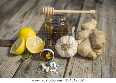Ginger,lemon,honey and garlic fresh and healthy food products concept for natural medicine.