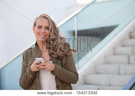 smiling woman with cell or mobile phone