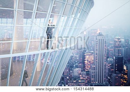 See through glass building exterior with businessmen inside. Night city background. 3D Rendering