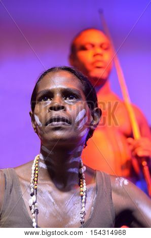 Yirrganydji Aboriginal woman and men during cultural show in Queensland Australia.