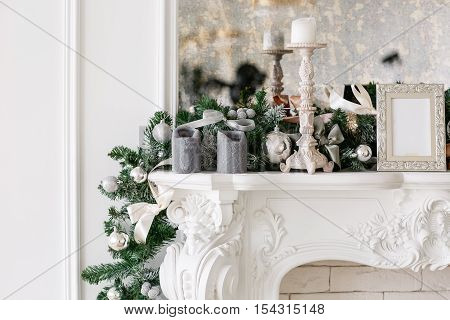 Christmas morning. classic apartments with a white fireplace, decorated Christmas tree, bright sofa, large windows.