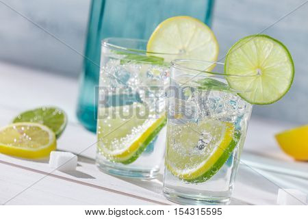 Close-up on lemon drink with ice on wooden table