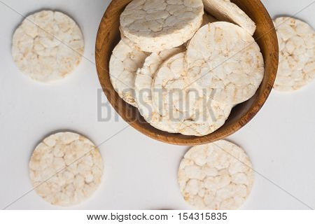 Rice cookies into a bowl on white background