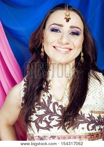 beauty sweet indian girl in sari smiling, lifestyle people concept close up
