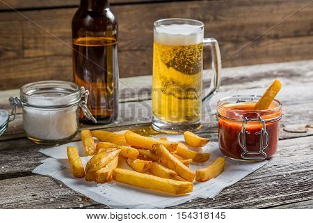 Closeup Of Homemade Fresh Fries With Cold Beer