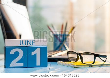 June 21st. Day 21 of month, wooden color calendar on office background. Summer time. Empty space for text.