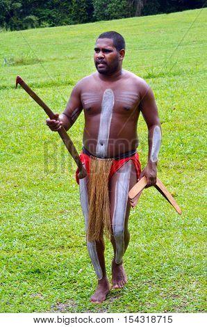Yirrganydji Aboriginal Warrior Carry Boomerangs