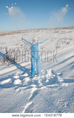 Happy Young Woman In Blue Ski Suit On Snow