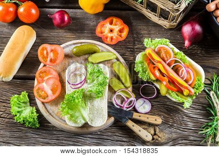 Ingredients for homemade hot dog on wooden table