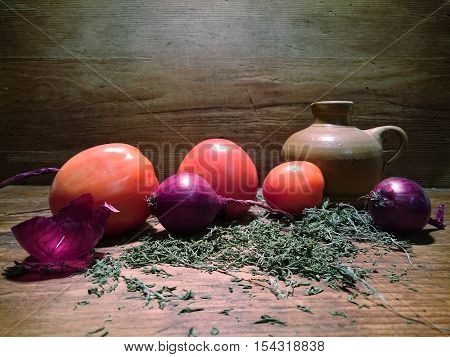 A table with vegetables on a wooden background