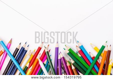 Color pencils topsy-turvy pile with copy space
