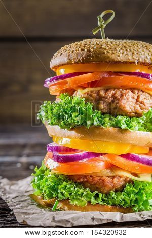 Closeup of double-decker homemade hamburger on wooden table