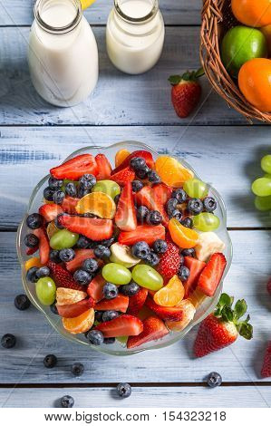 Enjoy your fruit salad on wooden table