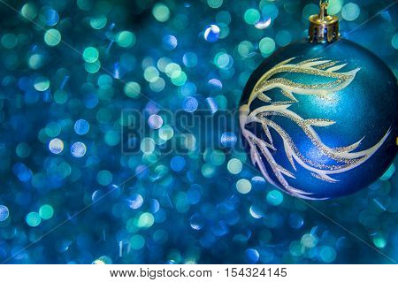 Christmas star closeup and baubles on blue blurred background Christmas toy on a blue background.