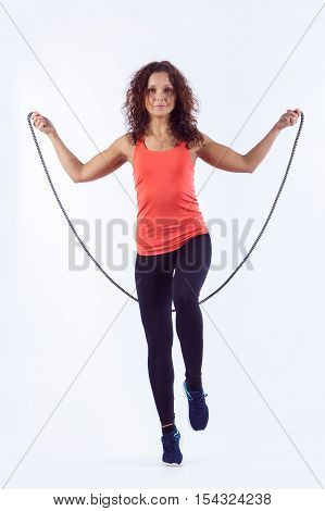 Portrait Of Muscular Young Woman Exercising With Jumping Rope On White Background.