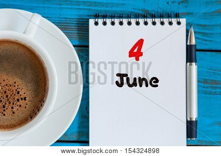 June 4th. Image of june 4 , calendar on blue background with morning coffee cup. Summer day, Top view.