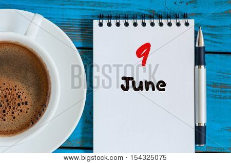 June 9th. Image of june 9 , calendar on blue background with morning coffee cup. Summer day, Top view.