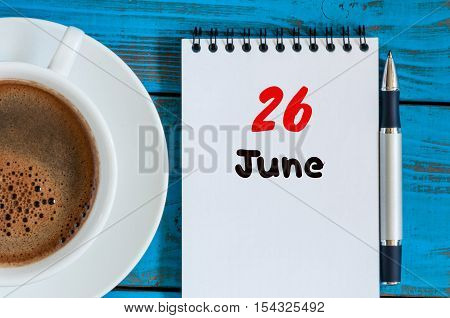 June 26th. Image of june 26 , calendar on blue background with morning coffee cup. Summer day, Top view.