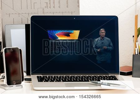 PARIS FRANCE - OCT 28 2016: Apple Computers website on new MacBook Pro Retina with OLED Touch bar in geek creative room showcasing Apple Keynote presentation of MacBook air replacement